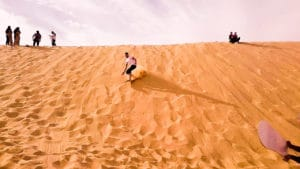 sand boarding in dubai desert safari by gotripair